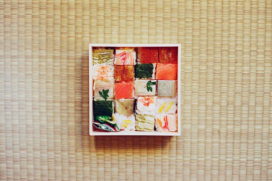 Directly Above Shot Of Various Sushi In Bento Box On Tatami Mat