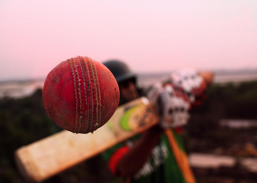 Conceptual cricket shot, close-up of a ball coming off the bat