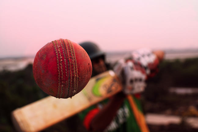 Conceptual cricket shot, close-up of a ball coming off the bat