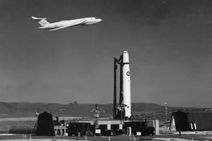 The RAF in the Cold War: a Victory plane flying behind a Thor missile, c.1960