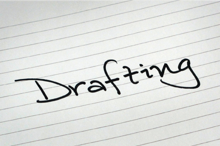 A page with the word 'Drafting' written down.