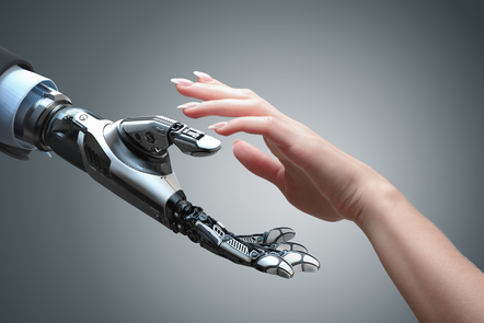 A human hand reaching out to a robot hand
