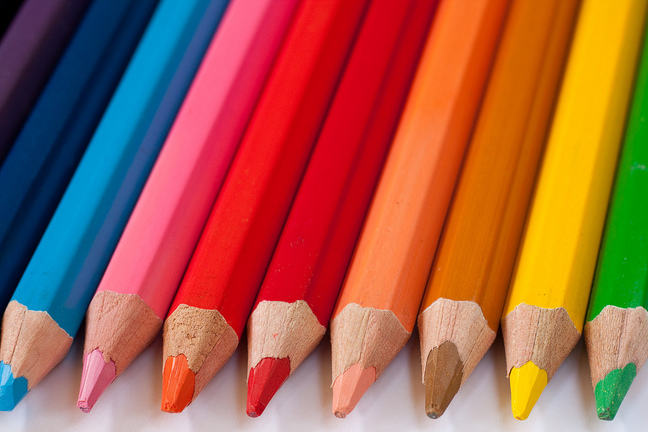 A Row of Coloured Pencils Placed Together with Their Sharpened Ends Facing Forwards