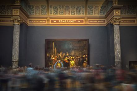 Public in a museum in front of a painting
