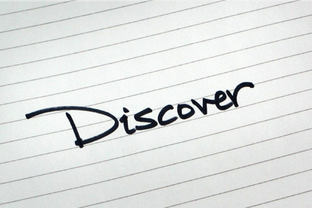 A page with the word 'Discover' written down.