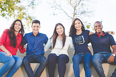 Five friends smiling