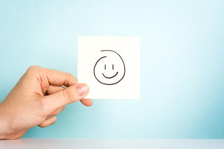 Happy emoticon or icon on blue background.
