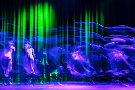 time lapse photo of performers on stage