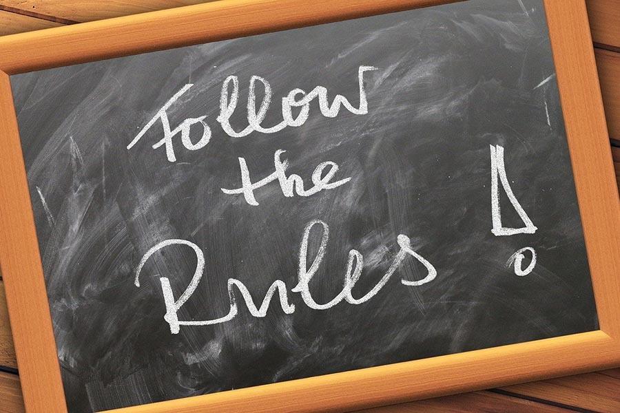 Follow the rules written on chalkboard