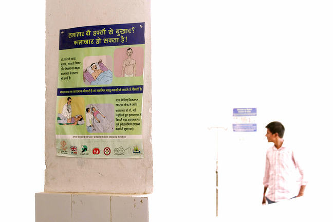 Corridor in local public health clinic in India. Poster about recognising VL symptoms on the wall.