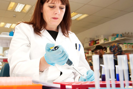 Woman pipetting