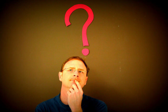 Man with red question mark above his head