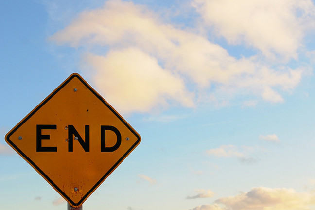 "Yellow road sign saying ""End"""