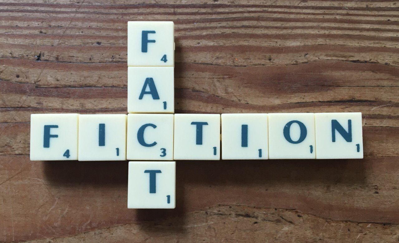 Fact and Fiction intersecting and spelled out in scrabble letters