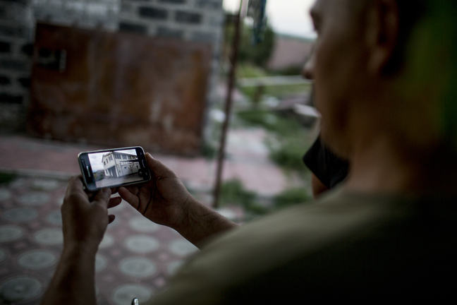 Image of a man showing a camera screen