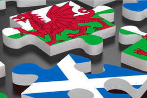 jigsaw of Welsh flag and Scottish flag pieces
