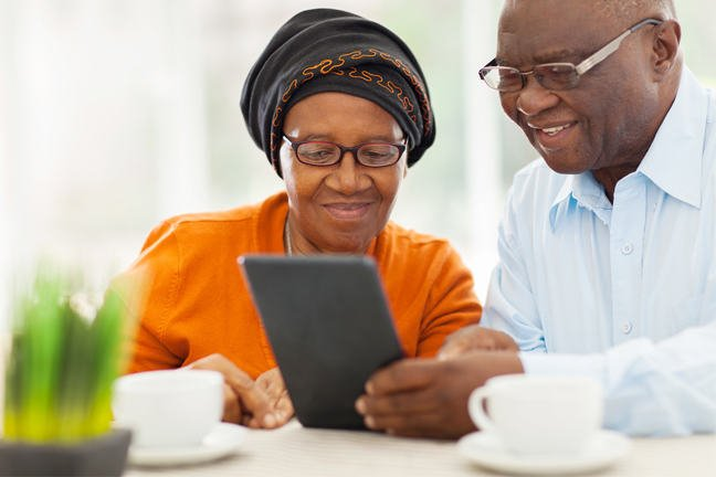Mature couple looking at a tablet together