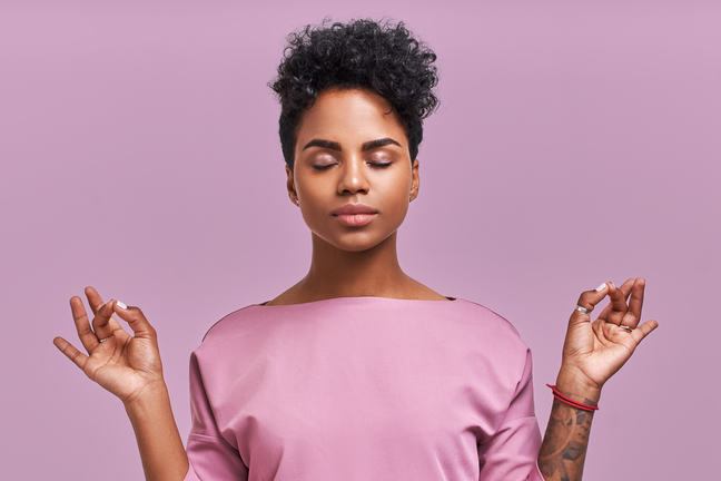 Woman meditating with her eyes closed