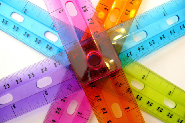 multicoloured tapes measures fanned out into the shaper of a star