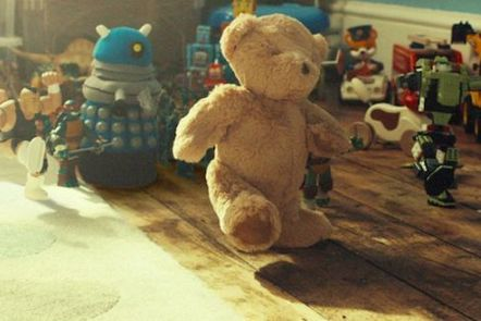 Teddy bear leads toys marching across wooden floor