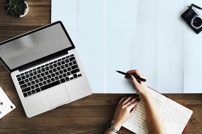 Laptop, pen, paper, pad