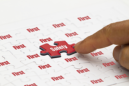 A puzzle with a red chip with SAFETY written on it