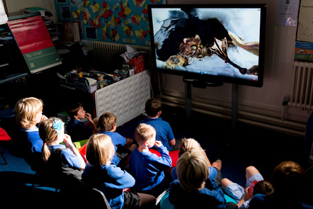 Children in a classroom watching an animation