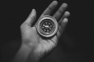Open hand with a compass