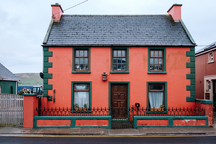 A picture of a small house in Dingle, Co. Kerry. It is red and green, with two floors.