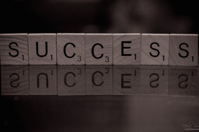"Scrabble tiles spelling the word ""success'."
