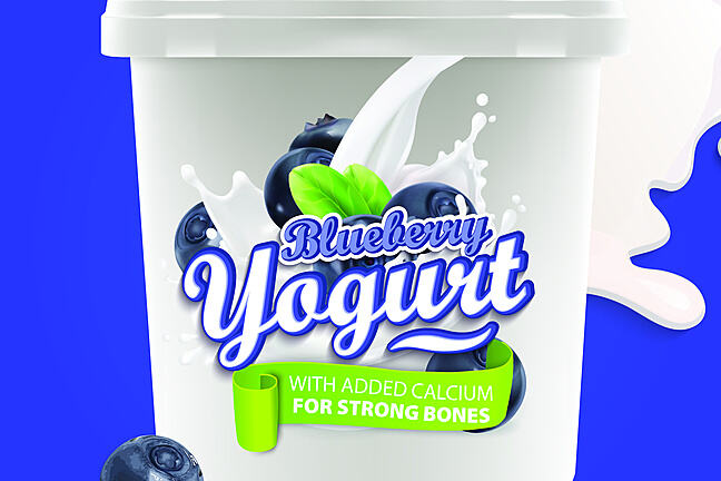 Blueberry yogurt pot with banner claiming 'with added calcium for strong bones'