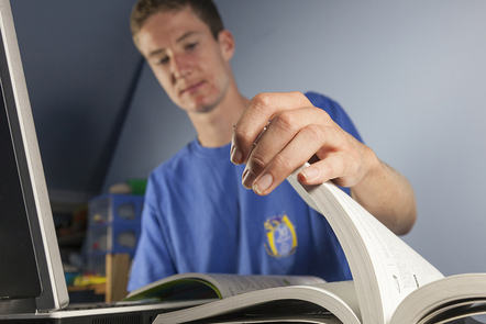 Student opening a book