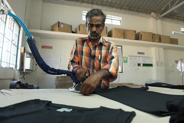 An Indian worker iron t-shirts for 3freunde