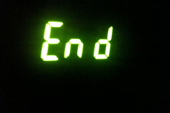Green neon sign saying 'End' on black background.