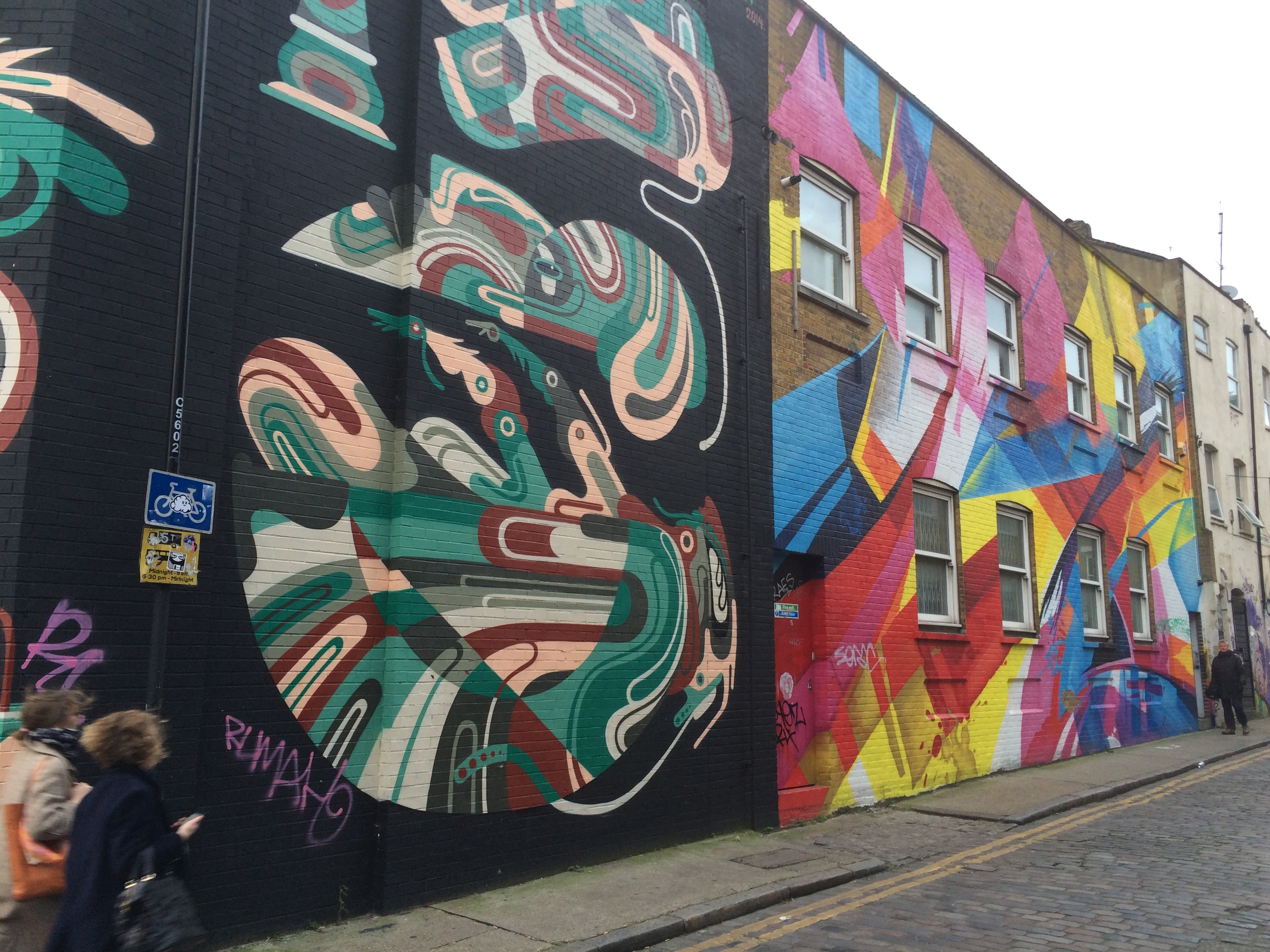 Graffiti painted on the sides of buildings in East London.