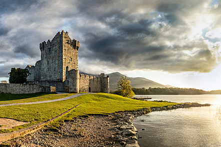 A beautiful ancient castle at a lake shore.