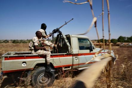 Niger Army troops on patrol near the Nigerian border in South Niger.