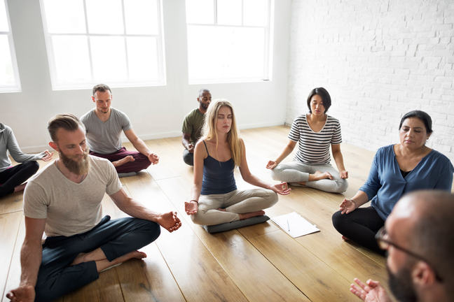 Group of people meditating.