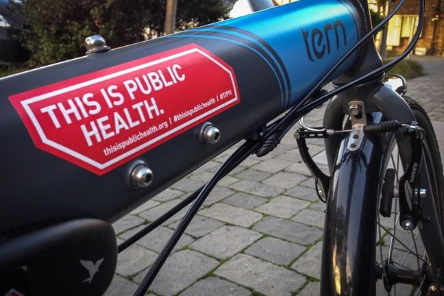A bike displaying the slogan 'this is public health'.