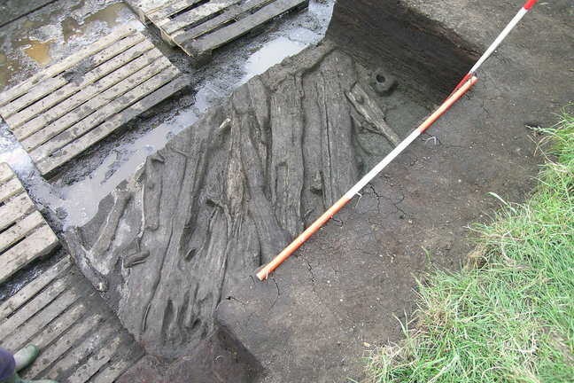 A piece of wooden platform which was found in 2010 next to the trench which had been excavated in 1985
