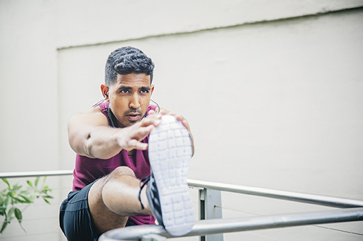 Man stretching in fitness clothing.