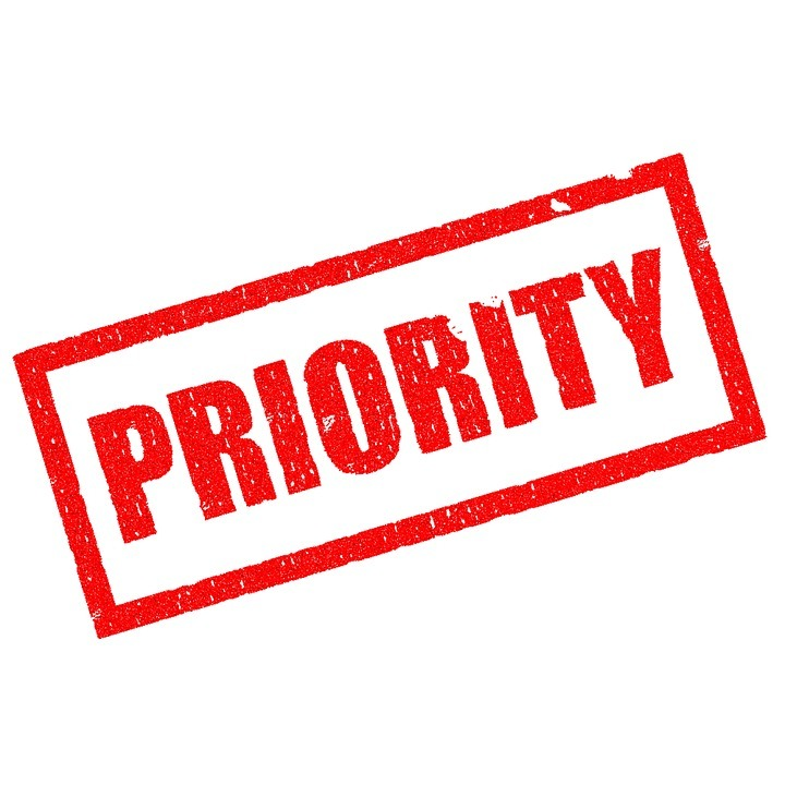 Red and white sign which says 'priority'