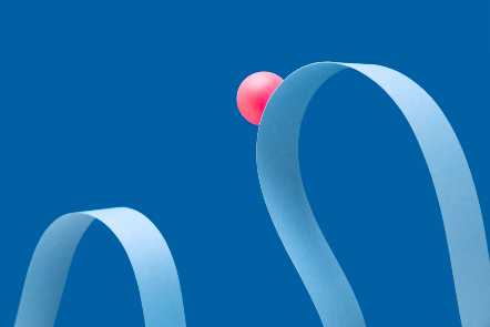 One pink ball travelling along a wave made of a strip of paper.