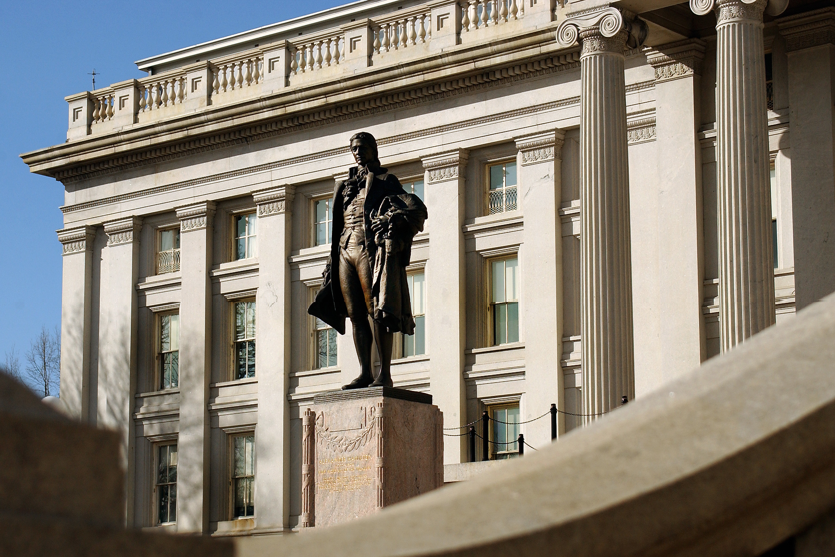 Statue of Alexander Hamilton in front of US Treasury Building