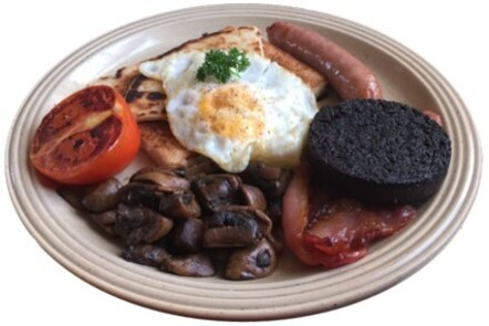 This image shows a plate with a cooked breakfast (bacon, egg, mushrooms, tomatoes, potato scones and sausages). .