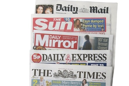 A photograph of various British Newspapers pilled on top of each other