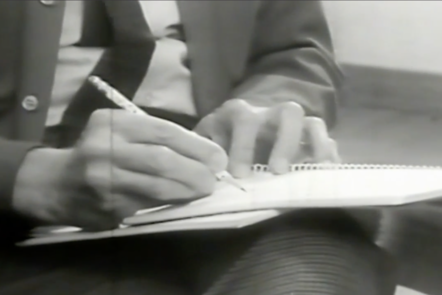 A screenshot from the archive video 'Indexing' showing Paul Nordoff writing in a notepad