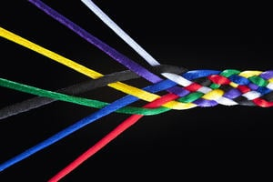 Strands of an interwoven multicoloured piece of rope