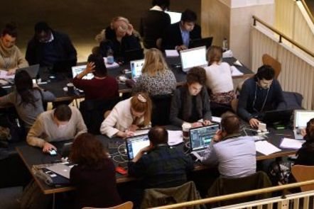 photograph of people reading at desks in the British Library
