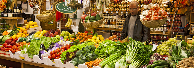A market stall full of fresh fruit and vegetables, illustrating our need for food security